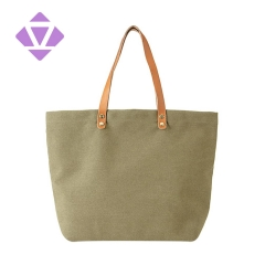 canvas and luxury vegetable tanned leather tote bag