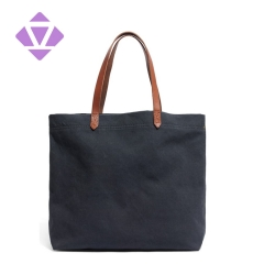 denim and luxury vegetable tanned leather tote bag